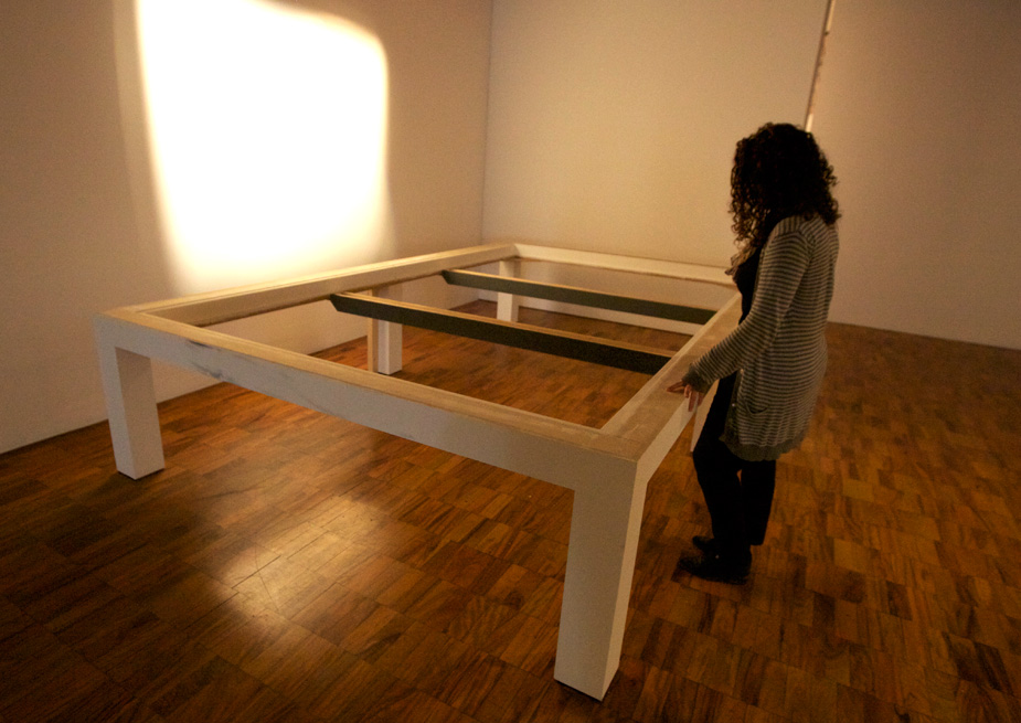 Inspecting the custom glass display table